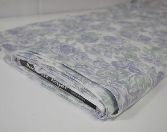 Poly-cotton light weight floral fabric. Lilac and green on white background.