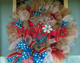 Welcome wreath in burlap, red, and teal blue with big bow