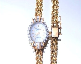 14k Gold & Diamond Croton Watch With Mother of Pearl Lady Prevard Movement