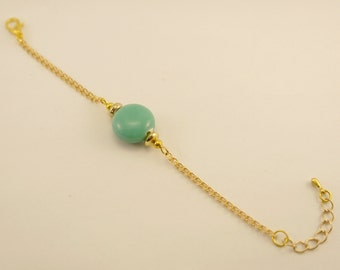 Bracelet in gold metal and pearls ceramic round and flat Green