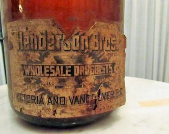 """large antique bottle """"Henderson Bros Wholesale Druggists est 1858 Victoria & Vancouver B.C."""""""