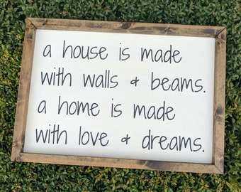 A House is Made with Walls and Beams. A Home is Made with Love and Dreams - Wood Sign