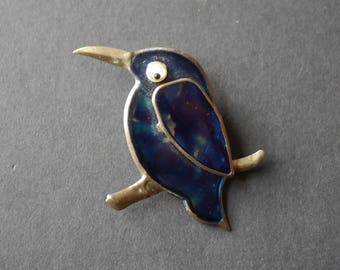 Pressed metal and blue lacquer bird brooch with googly eye