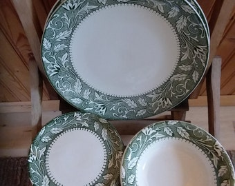Green and white transferware china. Two plates,  five bread plates, one soup bowl.