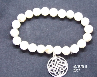 N021711 White and Grey Cramic Beaded Bracelet With a Celtic Metal Charm.