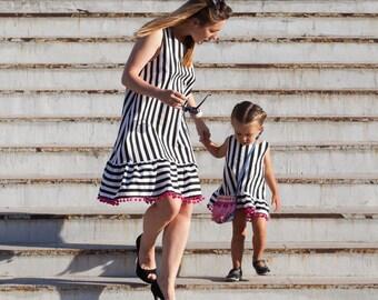 Dress, stripped dress, sundress, red pom poms, black and white dress, girls clothing, girls dress, kids apparel, girls garment,