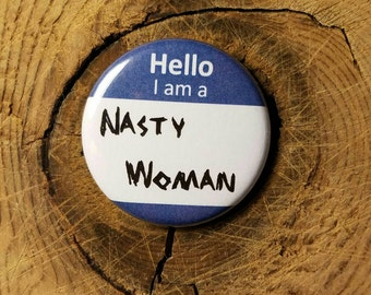 "I Am A Nasty Woman (1-1/4"" Pinback Button)"