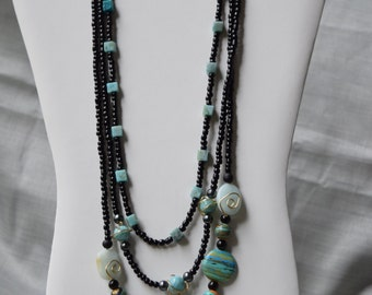 3 Chain blue and black beaded necklace
