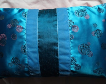 Asia series 4: (12 x 20) 30x50cm cushion, fabric turquoise Chinese motifs, blue dupioni silk, blue velvet Ribbon, fuchsia cotton.
