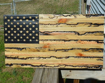 Electrified American flag with engraved stars using 2000+ volts size: 24 x 13 inches