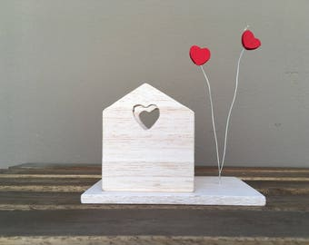 Little wood house candle with floating hearts