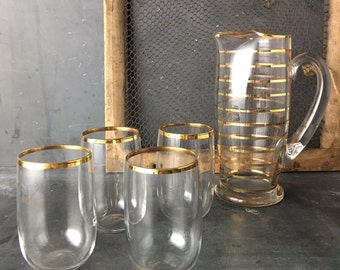 Glass Pitcher with 4 glasses with gold stripes