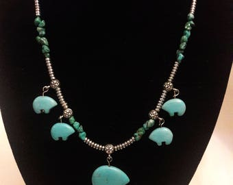 Turquoise beaded necklace with magnesite bear fetishes