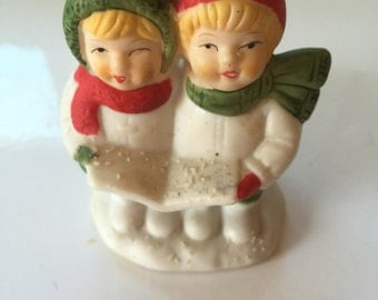 Vintage Christmas carolers in snow candle holder
