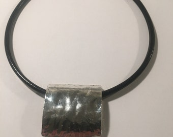 Ladies black leather and square hammered silver plate pendant