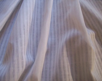 a thin white cotton vintage fabric