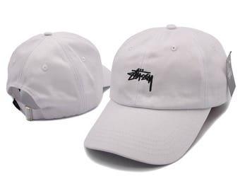 white stussy baseball cap