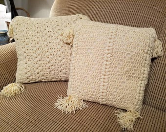 Set of two cream crocheted tassel pillows