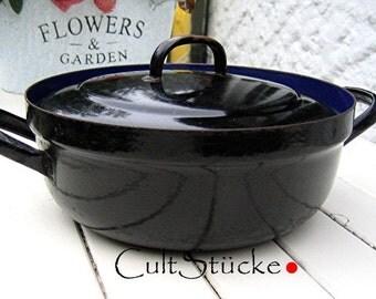Vintage of old enamel pot black
