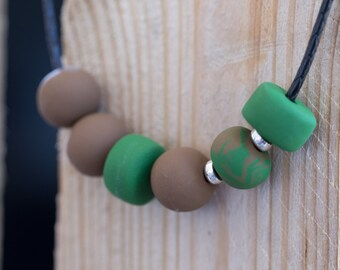 Green and brown polymer clay necklace with silver embellishment beads