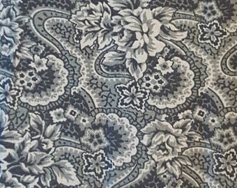 Blue floral fabric with swirls