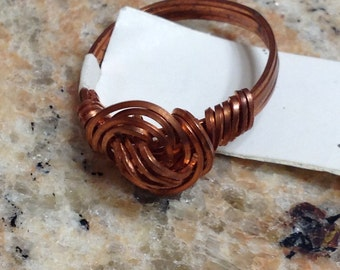 Copper swirl knot ring