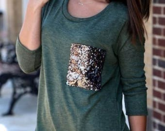 Green top with glitter pocket.