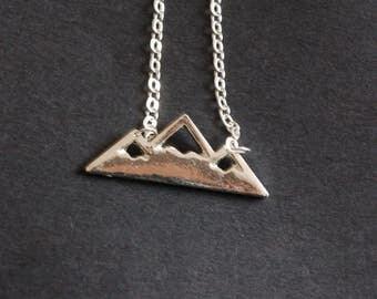 Silver tone mountain landscape necklace