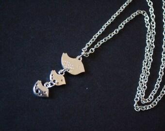 silver tone baby birds necklace