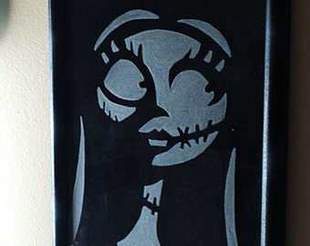 Custom etched glass silhouette of Sally