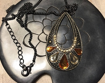 Necklace color black, bronze, orange, and green
