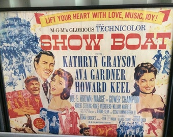 vintage movie poster in glass frame very good condition