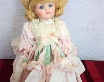 "PORCELAIN Doll Head hands and feet Soft BODIED Blond Hair Blue eyes 10"" TALL On Stand"
