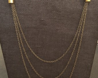 multi-strand chain bullet necklace