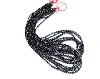 AAA quality natural BLACK DIAMOND faceted barrel shape (unique shape & finest quality)\16 inch strand approx