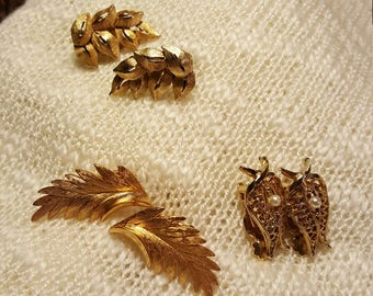 3 sets of vintage clip on gold tone earrings