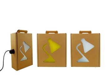 10 reusable cardboard boxes in lamp. Recyclable packaging
