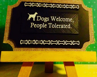 Dogs welcome, people tolerated easel