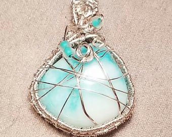 Light blue natural wiresources wrapped stone pendant