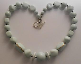 Pale blue Kazuri ceramic fair trade hand made 19 inch necklace.