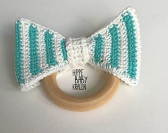 Wooden teething ring with crochet striped bow