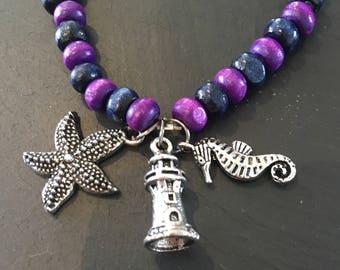 Purple beaded sea charm bracelet