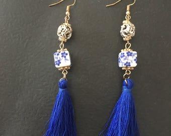 Blue tassel and bead earrings