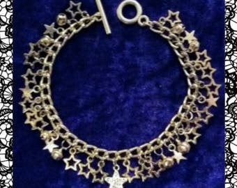 Stars and bells charm bracelet