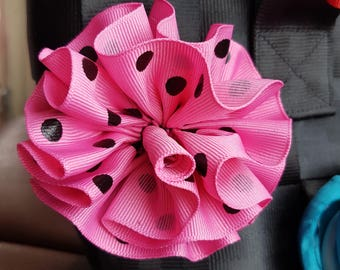 Pink and black polkadot rosette for Harveys bag