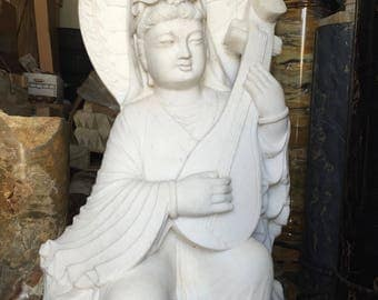 Vintage hand-carved Kuan Yin statue in white marble