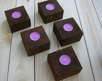 The candle holders of wood different sizes. Diameter 4cm