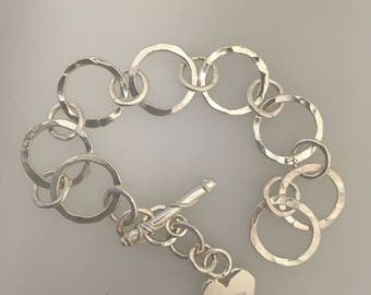 Hammered handmade charm bracelet with small heart