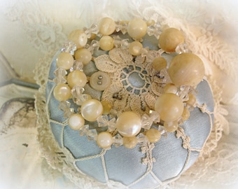 antique mother of pearl and crystal necklace carved clasp gRaduated mother of pearl rounds crystal bicone spacers needs restrung or reUse