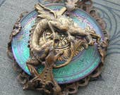 Exquisite Emerald sparkle Czech glass dragon wrapped in vintage French brass filigree. A beaders component